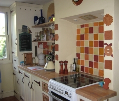 This cooker surround has a wonderful collection of our tiles in Lewes (UK)