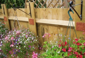 Our tiles have a lovely flowery spot fixed to fence timbers in Twickenham (UK)