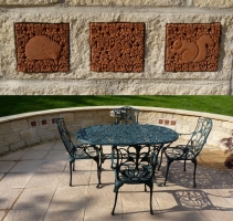 Ingenious use of our tiles cut into a patio stone wall in Wells (UK)