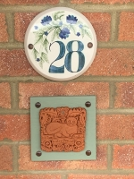 An adored Fine Cat tile mounted on wall in Deal (UK)